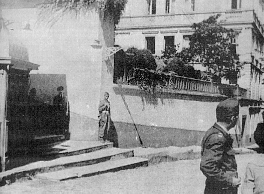 "The entrance of the Ecumenical Patriachate ""guarded"" by Turkish soldiers. Patriarch Athenagoras I and other clerics, were held under confinement inside the building like hostages."